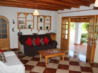 Lounge area leading to pool. With TV, sofas - ideal for relaxing