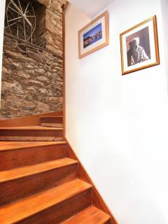 staircase to the bedrooms and upstairs bathroom