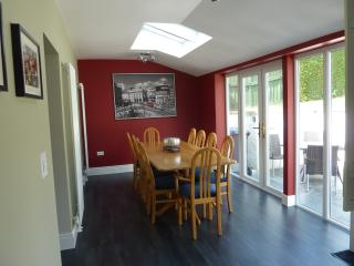 Lovely light dining area that seats 10 people with patio doors leading out to the patio area.