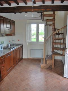 Papavero kitchen and spiral stairs to first floor