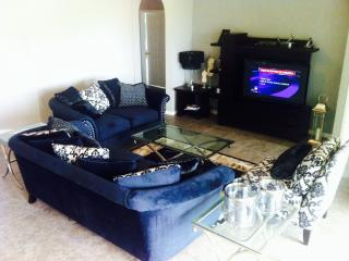 LIVINGROOM  WITH ENTERTAINMENT CENTRE FREE WIFI, CABLE TV, AND FREE CALLS TO USA & CANADA