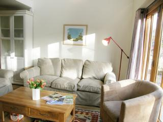 Bright living area with comfortable sofa and armchair