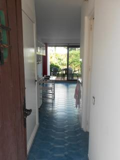 view from the door, cupboards on left, shower room on right
