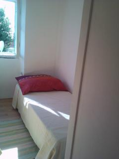 Smaller bedroom (8 m²) with one single bed. On request, we can add one extra single bed.
