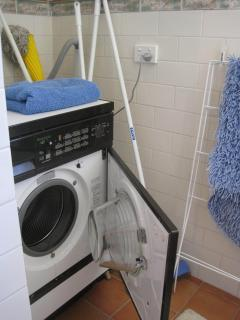 Front Load Washer and Dryer plus iron, ironing board, hair dryer