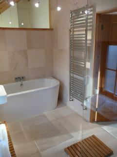 Bathroom 1 with tub bath and heated towel rail