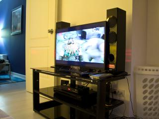 Bedroom has 32' LED Sony TV(wifi ready) w/ cable channels, DVD player, speakers and a laundry b