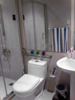 Walk in shower with hot/cold water, toilet with hand-held bidet spray