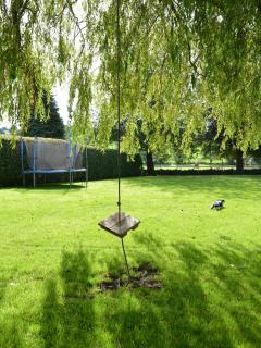 large private garden with swing and trampoline, ideal for children to run around
