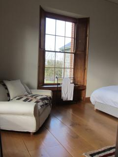 Reflection of the Garden Room showing wide floorboards and view