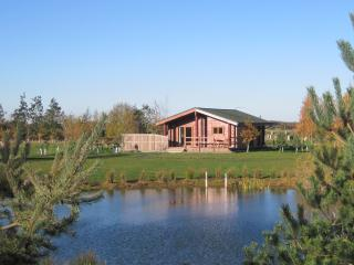 Sit and relax in the sunshine at your lodge overlooking the lake.