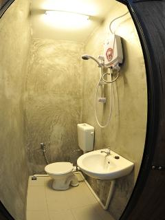 Bathroom with hot & cold shower, we have 2 bathrooms(shared) in the house.