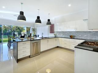 Open plan kitchen with views over the pool & Nerang river, (little ones are always in sight).