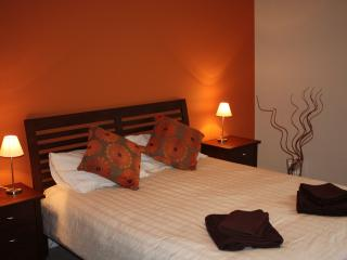main bedroom with king-size bed, ample storage and fold-down bed