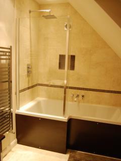 Ensuite bathroom with bath, shower and under floor heating