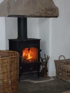 Get cosy by the log-burner In the lounge