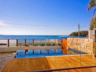 Sun drenched deck with private pool