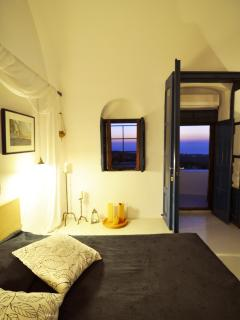 The main double bed on the sunset
