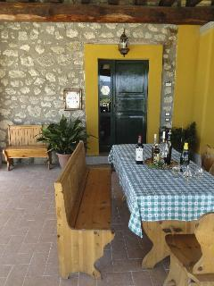 Under the porch, enjoy the company of ancient stones, wooden beams, good wines and good food!