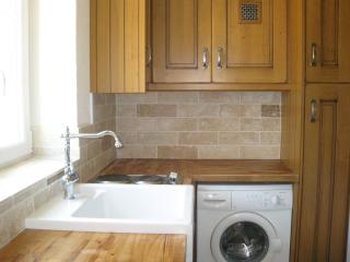 A handy utility with second hob, belfast sink, washing machine, two fridges and second dish washer.