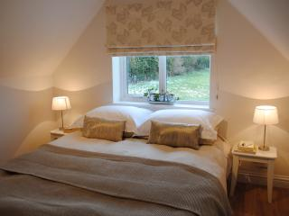 Cosy bedroom with views of open fields