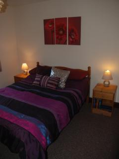 Bedroom one with double bed. Travel cots are available if required