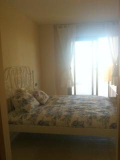 Master bedroom with doors to terrace