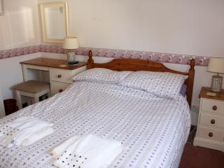 The main double bedroom at Honeysuckle Cottage