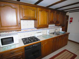 Saddlers Cottage kitchen, with full size hob and oven, microwave, fridge, freezer etc.