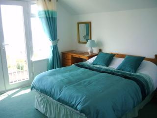 Double bedroom with views across Looe Bay.