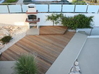 Extended decking leading to stone built barbeque