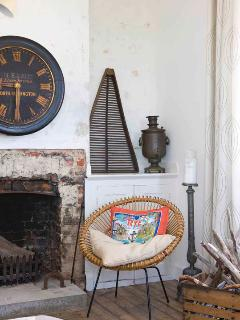 open fire place in sitting room with local antiques, stripped timber floors thru' out