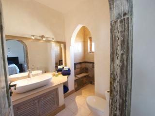 Master Bedroom en-suite bathroom with walk in marble shower featuring sea views