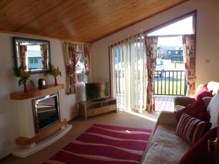 The lounge which is very light and has double patio doors onto your private decked balcony