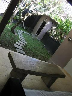 spacious private garden...littered with fragrant frangipani flowers, gentle lighting afterdark,