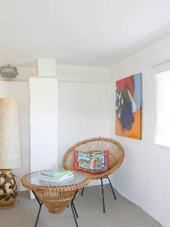 bright, lower ground floor bedrooms with funky furniture and nature reserve views