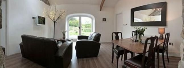Floor to ceiling arched windows offering stunning countryside views