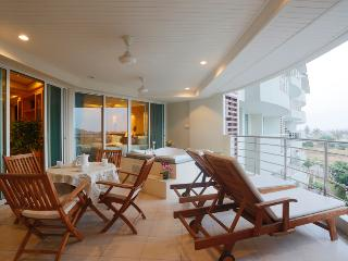 condo with jakuzzi on balcony