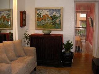 2-seater flanked by Japanese antique chest, accentuated with van Gogh's 'Dorfstrasse'