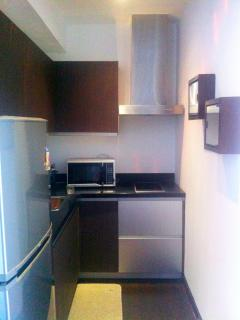 kitchen with fridge, stove, microwave, rice cooker, electric water kettle