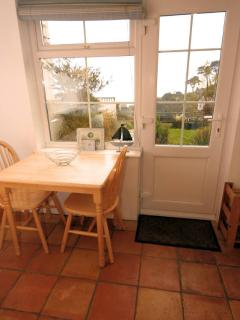 View to garden and sea from dining table