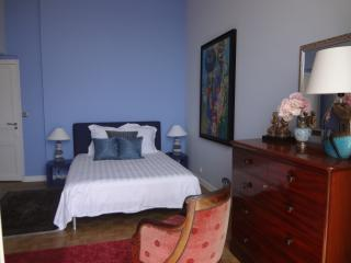 Blue double bedroom with sea view
