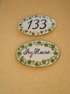 Our beautiful hand-painted house name