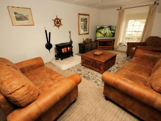 Lounge area with log burner and 46'' LED SMART TV with Netflix
