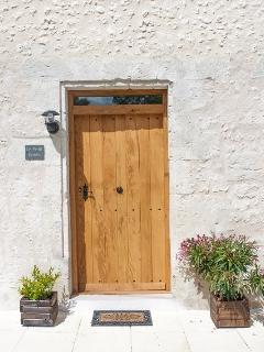 Le Petit Raisin's handmade oak door