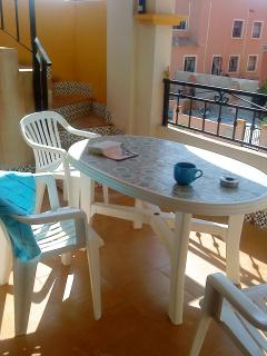 The Terrace with table and chairs for meals and drinks in the afternoon and evening sun