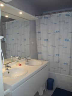 bathroom with bad and integrated shower
