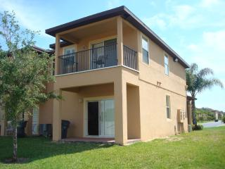 Rear view showing garden, patio and balcony and has barbecue area
