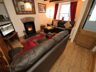 Lovely lounge with comfortable sofas and log burner