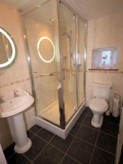 Luxury shower room with large walk in shower cubicle
